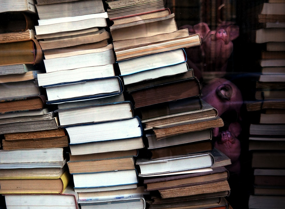 Books piled for self storage unit