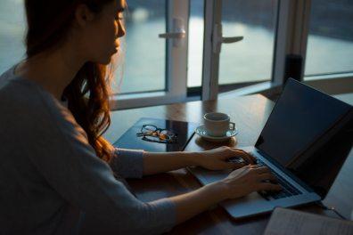 woman using laptop on desk